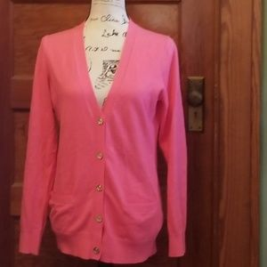 C. Wonder  pink cardigan with gold buttons